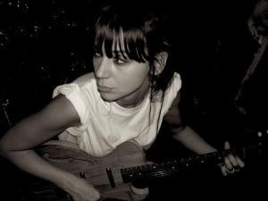 Cat Power on guitar